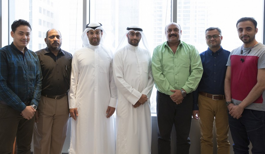 Image of 7 members of the Kuwait team, smiling